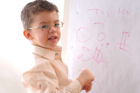 writing on glass: little man studying Stock Photo