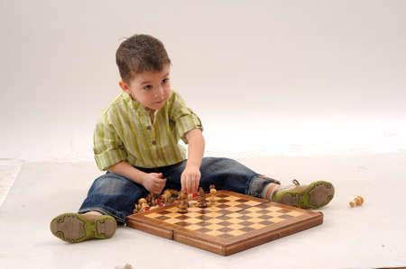boy playing chess Stock Photo