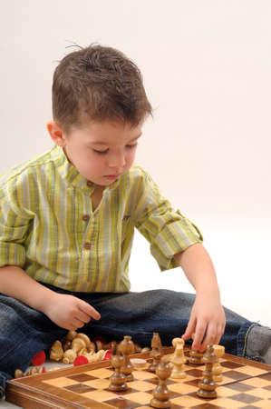 white kid playing chess