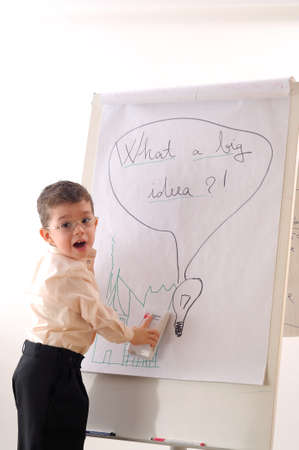 boy writing on white board photo