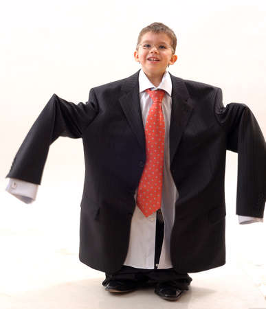 funny child posing with large suit