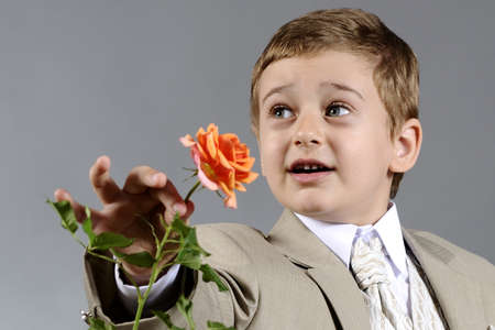 smiling child offering flower photo