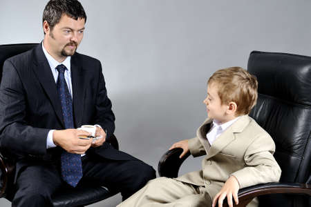 father and son working together in office photo