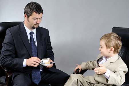 man discussing with young manager photo