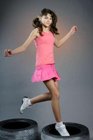 girl jumping in studio
