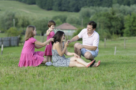 children playing with parents in summer season Stock Photo