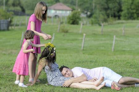 family relaxing in summer season photo