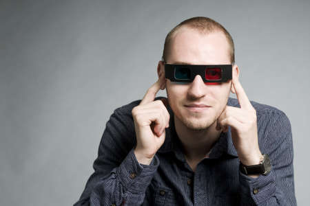 young man watching movie with 3d glasses Stock Photo