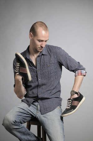 man admiring shoes