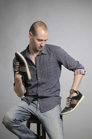 tennis shoe: man admiring shoes
