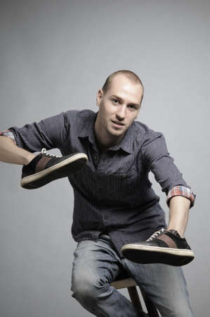 man posing with sneakers Stock Photo