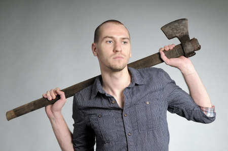 ax man: young business man posing with ax