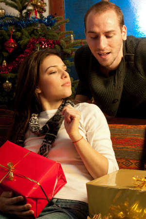 curious man and girl playing with christmas gifts Stock Photo - 11624262