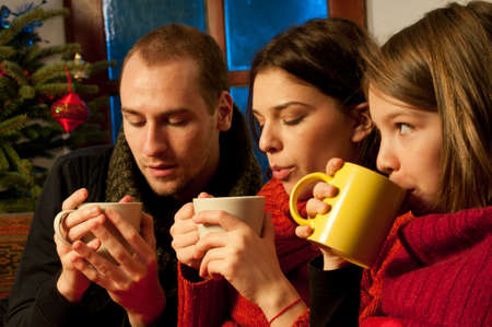 three teens drinking and celebrating christmas Stock Photo - 11624268
