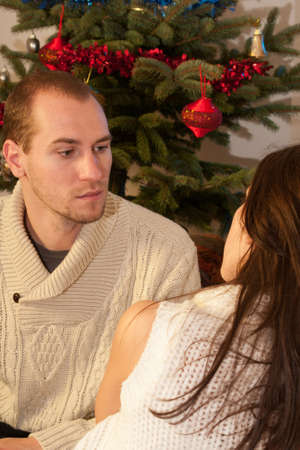 white couple communicating during christmastime