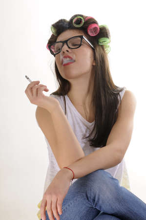 relaxed model resting and smoking cigarette photo