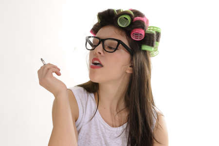 woman with curlers relaxing with cigar photo