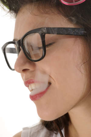 woman with glasses smoking cigarette photo