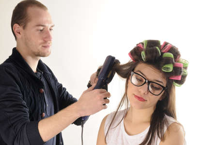 serious stylist brushing girl hair Stock Photo - 11916843