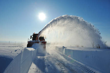 snowblow working in winter season Stock Photo