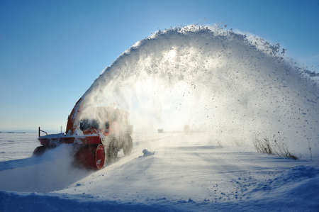 snow vehicle cleaning road