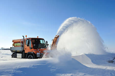 snow machine cleaning road Stock Photo