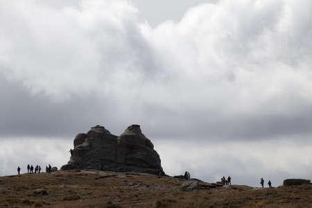 admiring: people admiring mountains range Stock Photo
