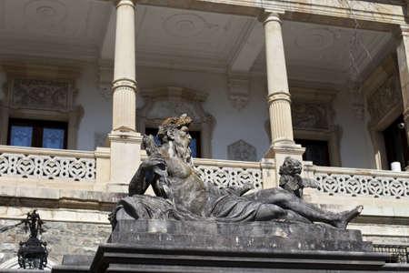 neptun: stone neptun statue against historical columns