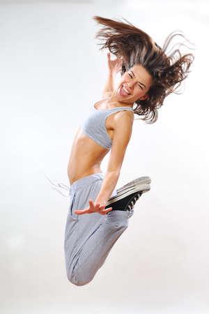 beautiful aerobic instructor jumping