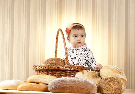 baby girl posing with bread products photo