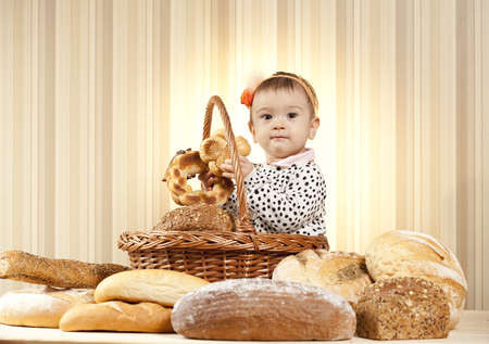 child choosing pastry products from basket photo
