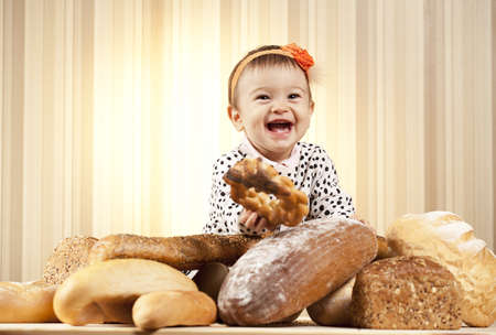 happy infant girl choosing bread