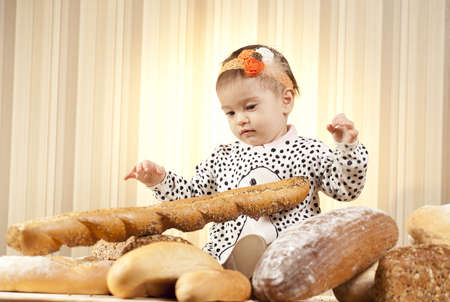 child eating french baguette photo