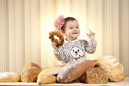 joyful child eating pastry products photo