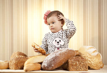 baby girl analyzing bread photo