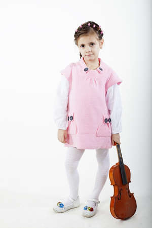 little violinist posing with instrument photo