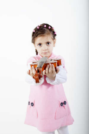 little violinist offering instrument photo