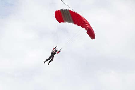 parachutists: parachutists landing and flying