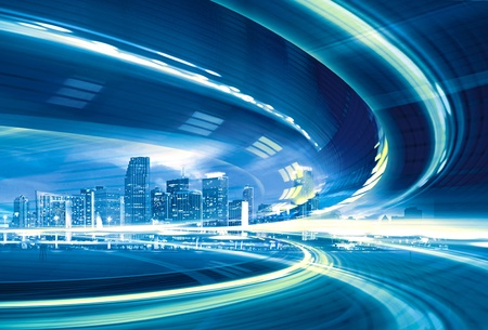 futuristic city: Abstract Illustration of an urban highway going to the modern city downtown, speed motion with colorful light trails.