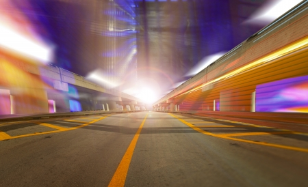 information highway: Abstract background, speed motion in urban highway road tunnel, blurred motion toward the light