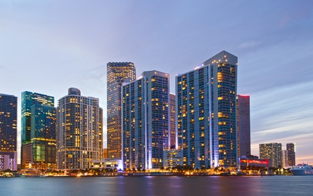 City of Miami Florida, colorful night panorama of downtown business and residential buildings photo