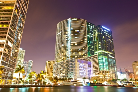 city of miami: City of Miami Florida, colorful night panorama of downtown business and residential buildings