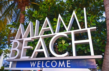City of Miami Beach Florida welcome sign with palm trees on a sunny summer day Editorial