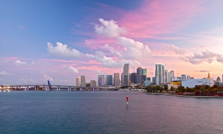 City of Miami Florida, colorful sunset panorama of downtown business and residential buildings and bridge