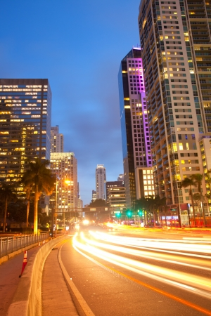 miami sunset: City of Miami Florida, traffic moving through downtown Brickell financial district