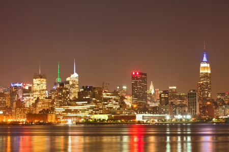 New York City, USA colorful night skyline panorama with illuminated landmark buildings in downtown business and residential districts