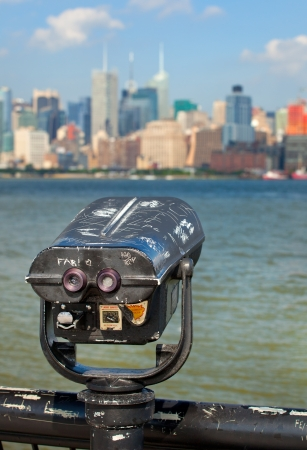 Observation deck with binoculars, view of New York city, Manhattan buildings photo
