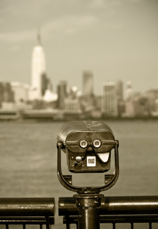 binoculars view: Observation deck with binoculars, view of New York city, Manhattan buildings  Vintage black and white photo