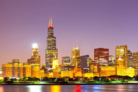 City of Chicago USA, sunset colorful panorama skyline of downtown with illuminated business buildings