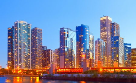 iconic: City of Chicago USA,   colorful sunset panorama skyline of downtown with illuminated business buildings